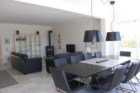 Dining area with a large table and 10 beautiful leather chairs