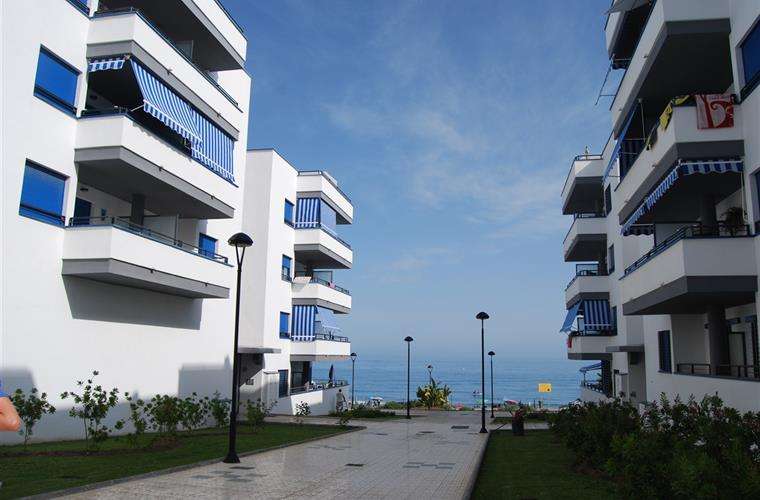 The apartment building with the sea in the background