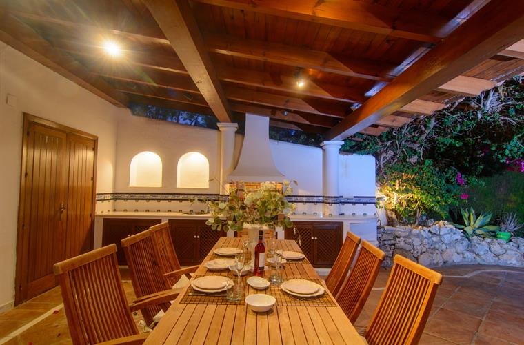 Wooden furniture for dining area on large terrace