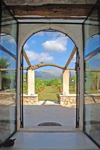 saloon door with terrace and view to the mountains