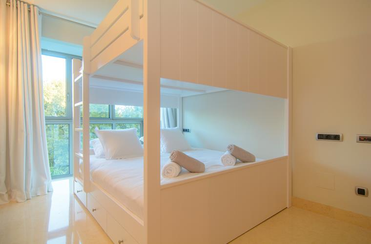 Guest bedroom with bunk bed and large windows
