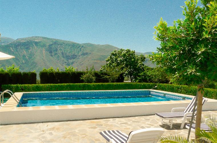 The pool terrace is 100% south facing, private and secluded