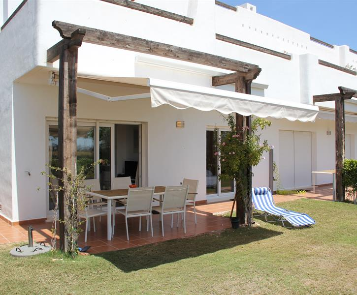 40/5000 Terrace with sunshade and two sunbeds