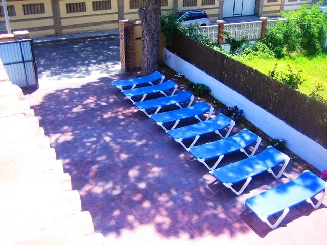 SUN LOUNGERS IN THE PATIO