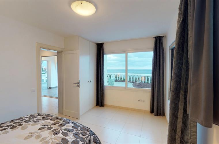 4th bedroom suite with views of the terrace on the beach and sea.