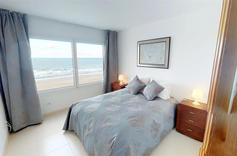 Master bedroom with wonderful views of the beach and the sea.