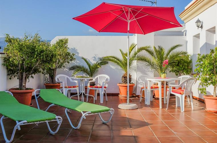 Sun terrace with table, chairs, umbrellas and lounge chairs for su