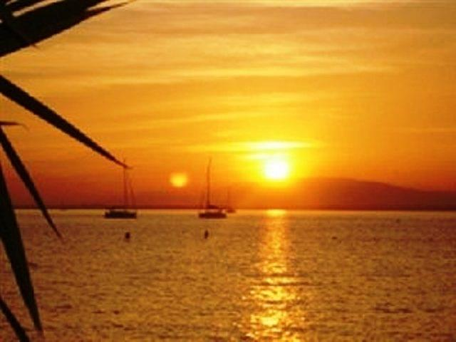 Typical sunset over the waters of mar menorand beyond