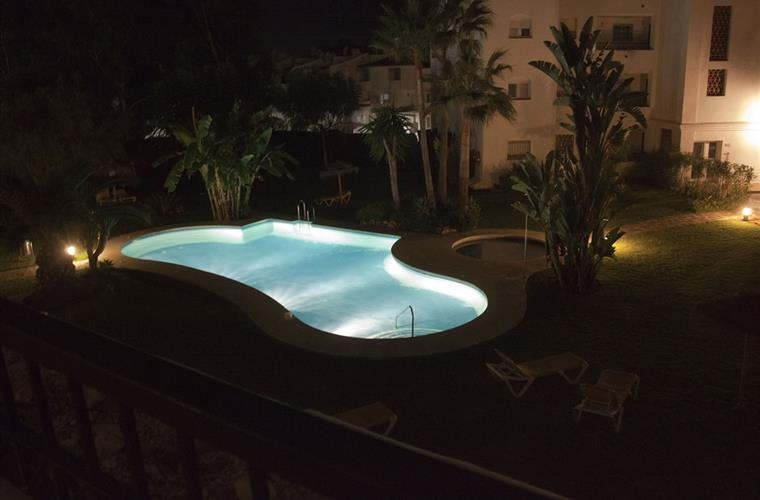 view on pool by night