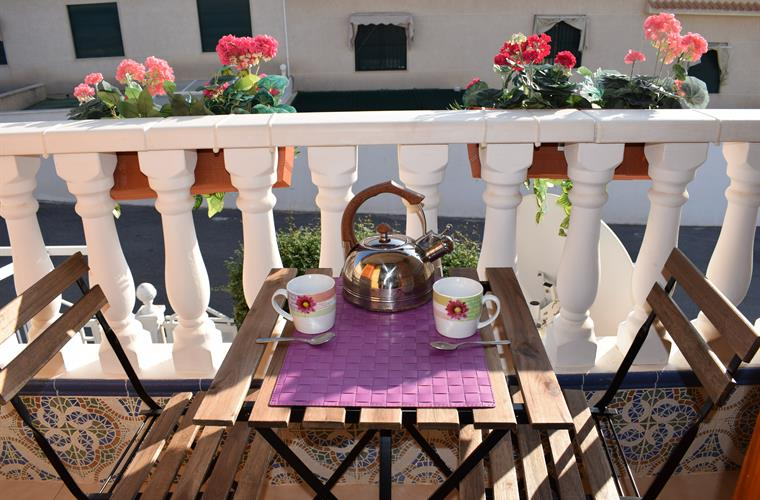 Take a cup of tea on our small balcony overlooking the pool
