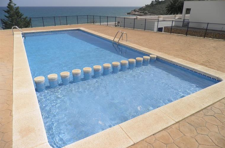 Shared pool with sea view, solarium, childrens section.