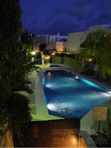 one of the three pools by night