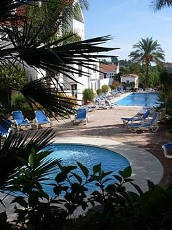 Main swimming pool with children pool with plenty of sun beds