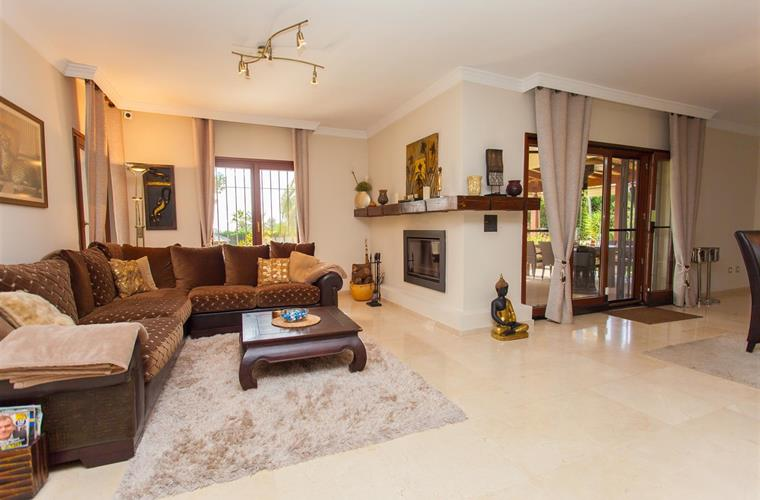 A spacious living with fireplace and television.