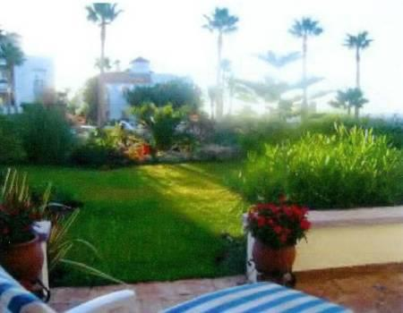 Tropical garden leading from the Terazza are to the pool and beach