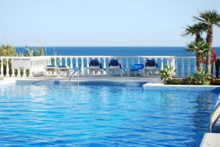 The largest of 4 swimming pools, facing the Mediterranean