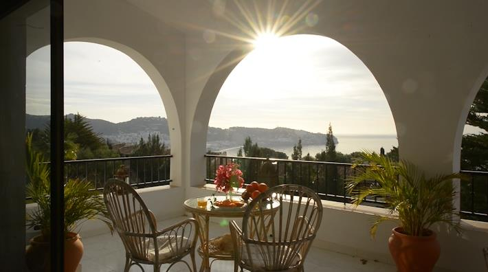 Upper terrace in morning sun with seaview.