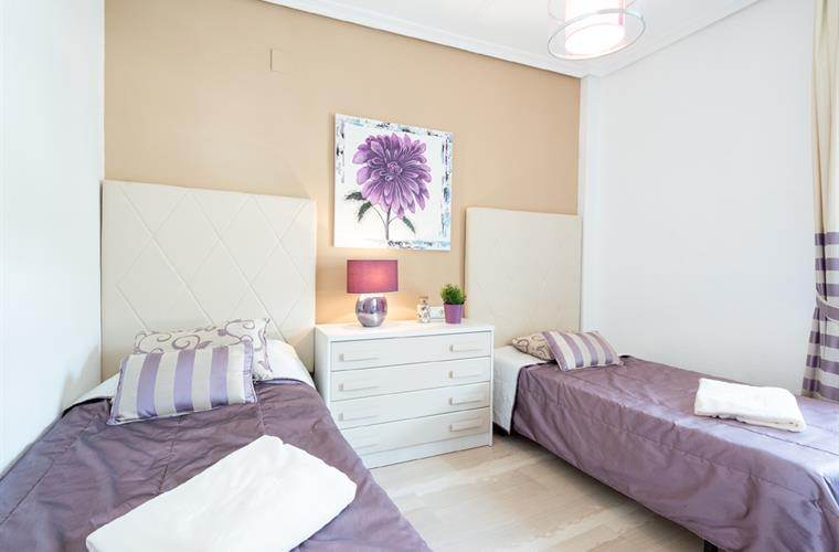 Bedroom with twin beds. All bedrooms have fitted wardrobes