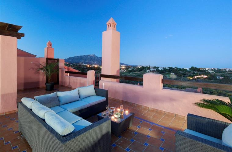 Roof top terrace by twilight with the mountain view