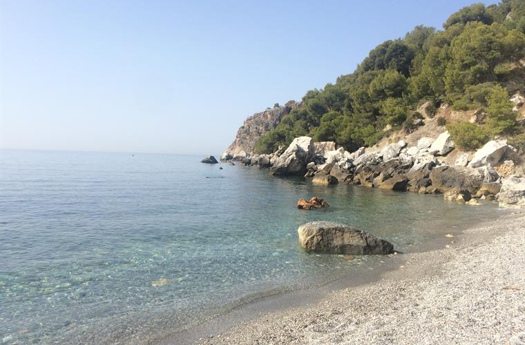 Secluded beach at the base of peninsula west of La Herradura.