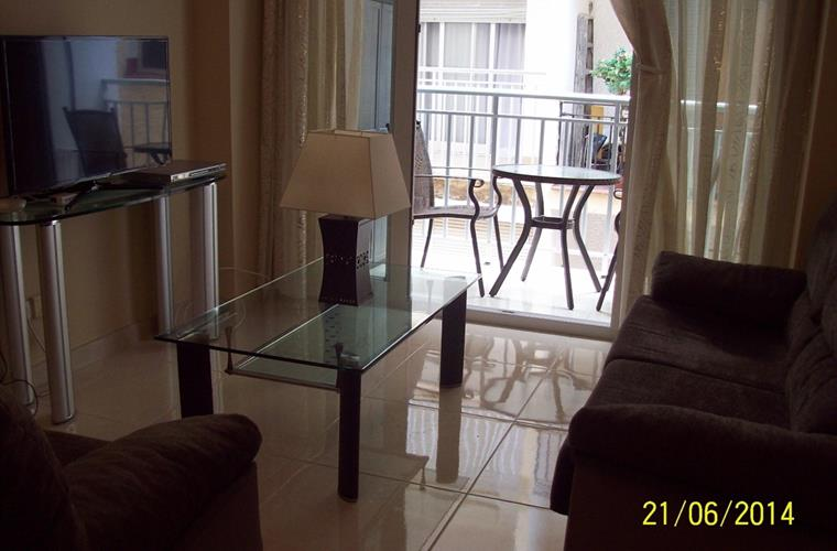 View from Lounge to Balcony with table & chairs.