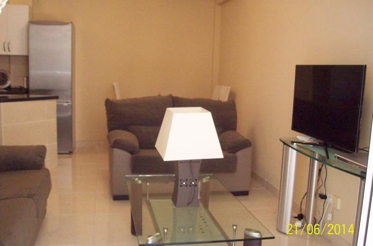 Lounge with large Smart flat screen TV.