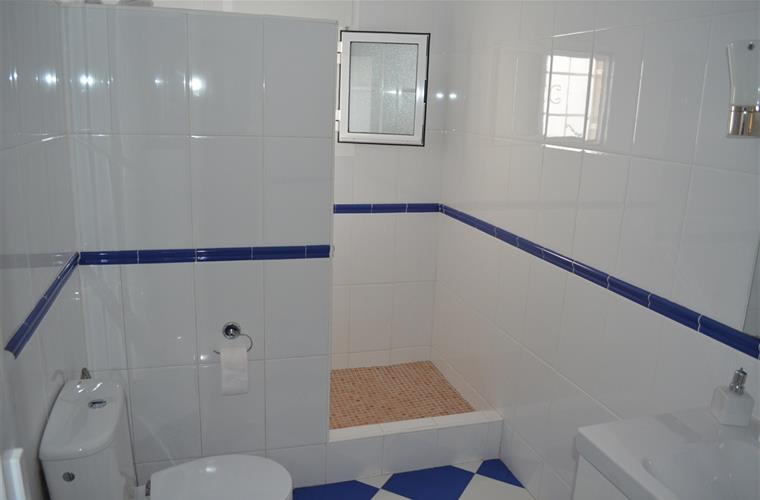 ensuite bathroom with third bedroom