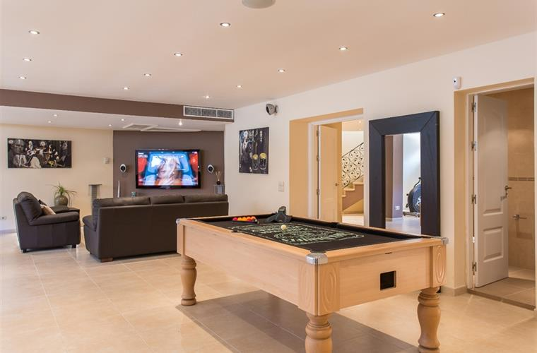 Kids den, complete with pool table and games consoles