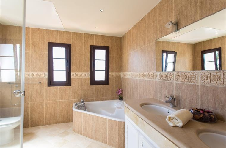 Master bathroom with corner tub and shower