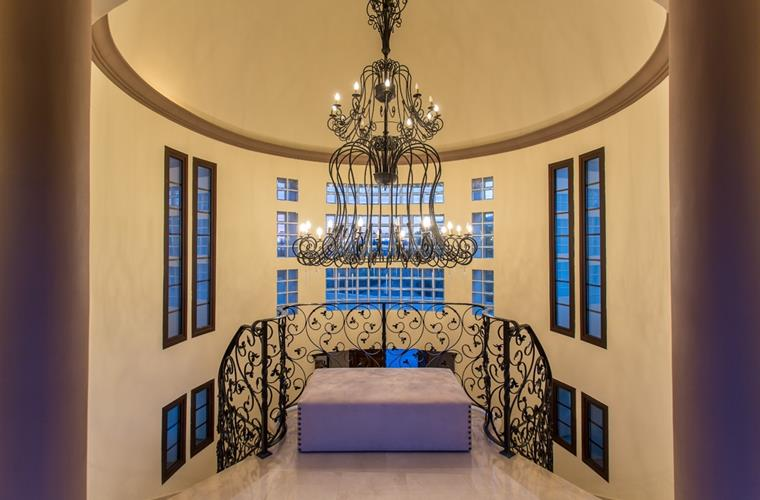 Interior hallway with domed ceiling and chandelier