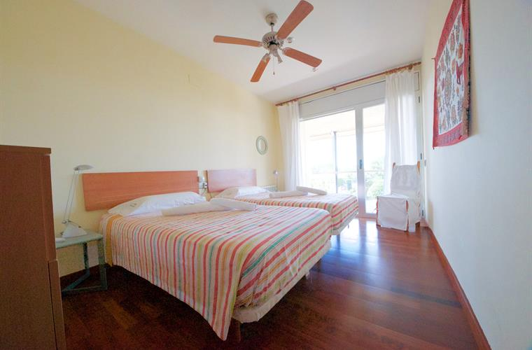 Bedroom two of the villa with access to balcony and seaviews