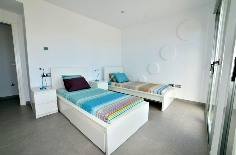 Third bedroom with twin beds & access to pool terrace
