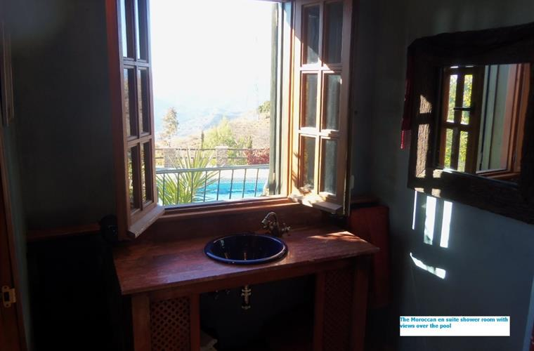 View of the pool from the Moroccan bedrooms en suite