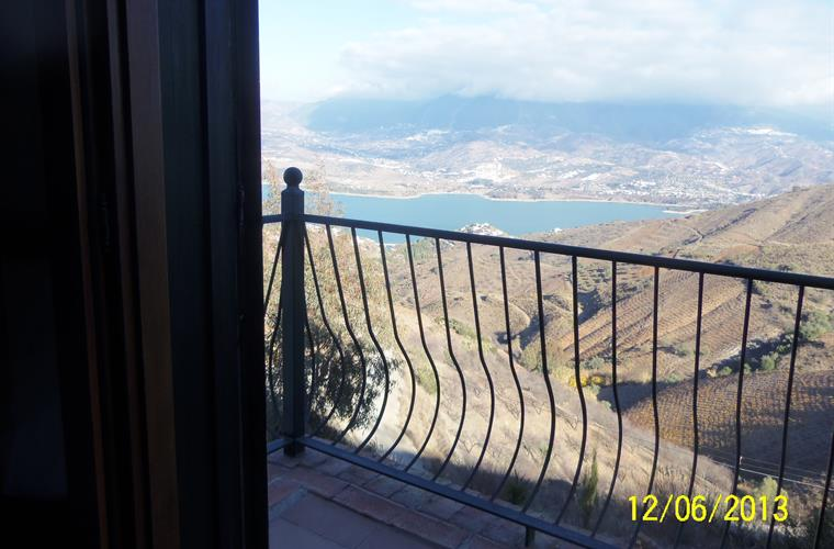 Views over Lake Vinuela from the bedroom balcony