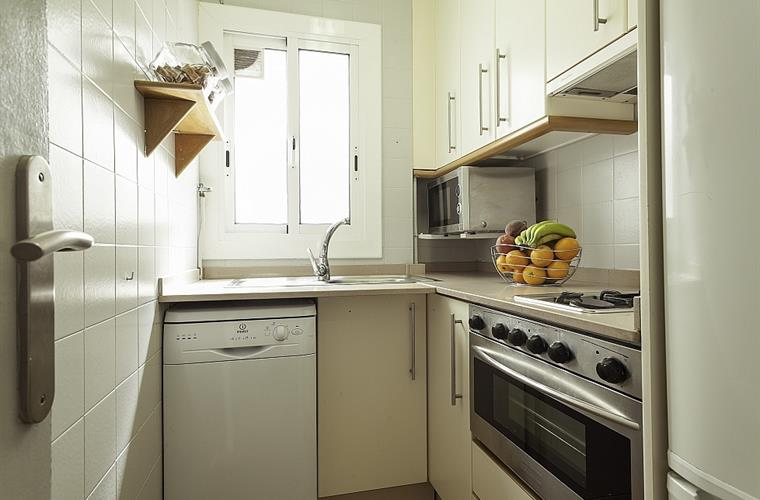 The kitchen is modern and fully equipped.
