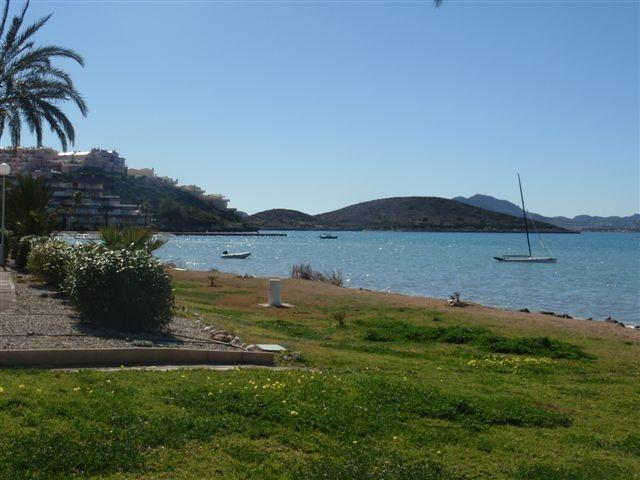 The Mar Menor beach surrounded by green lawns