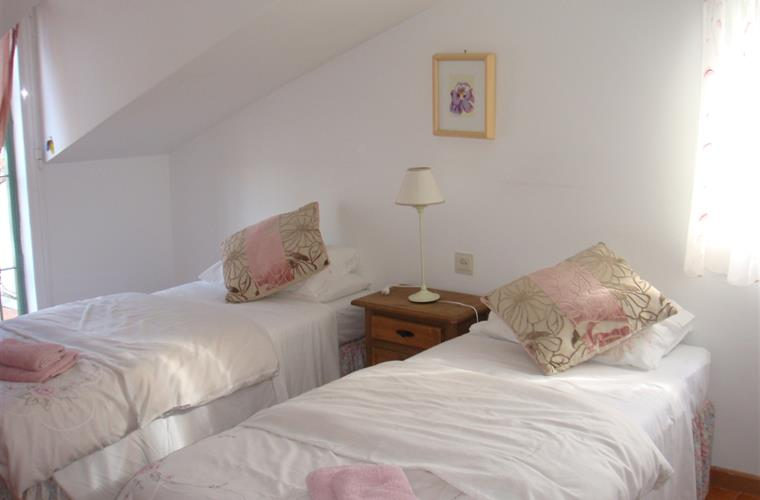 One of 2 twin bedrooms - this one has access to the roof terrace