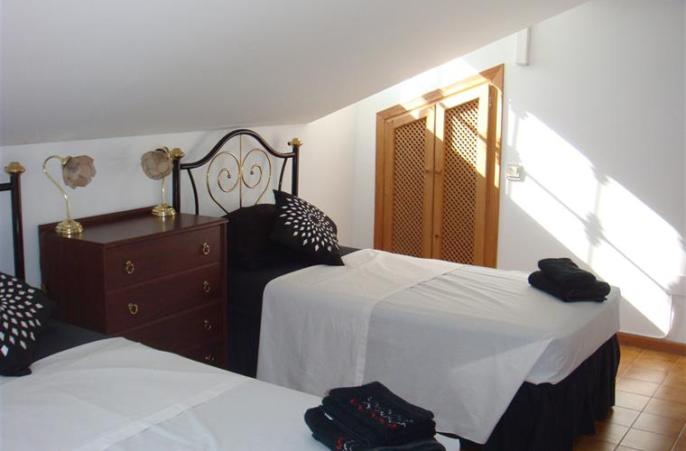 One of the 2 twin bedrooms