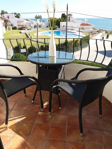 The small terrace on the 1st floor with stunning views of the sea.
