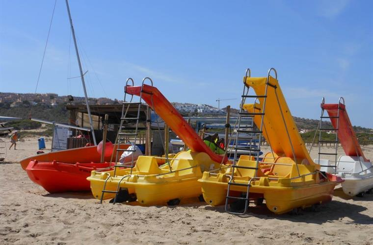 Pedaloes for hire on the Carabassi beach.