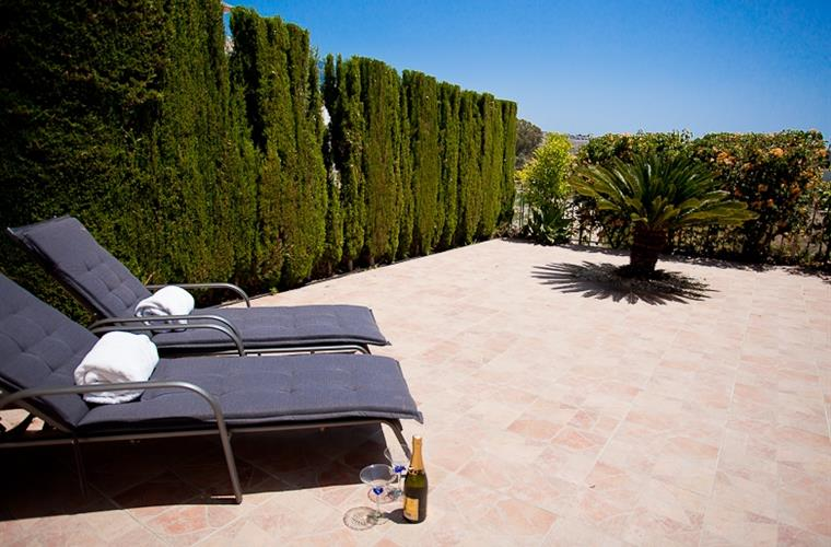 Sun beds in the private garden.