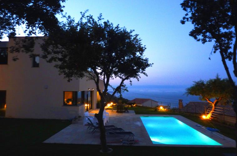 Night view of the property with seaviews