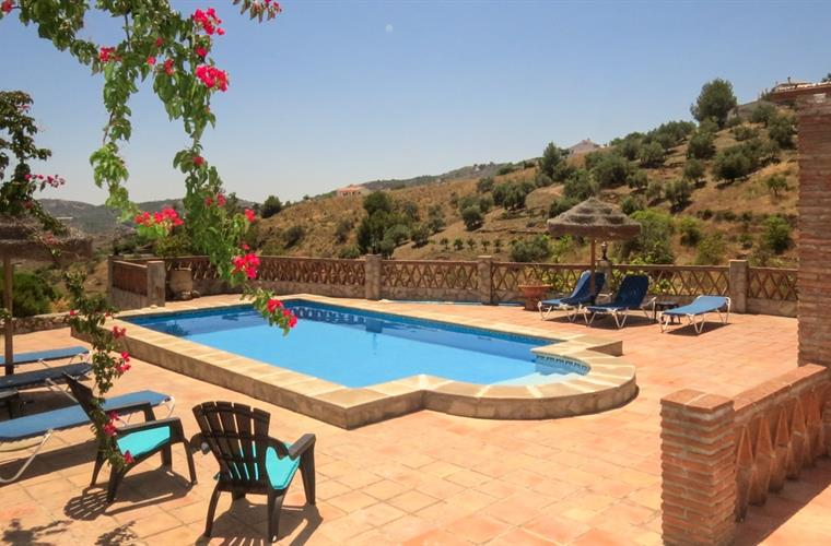 The terrace and swimming pool in a wonderfully tranquil location