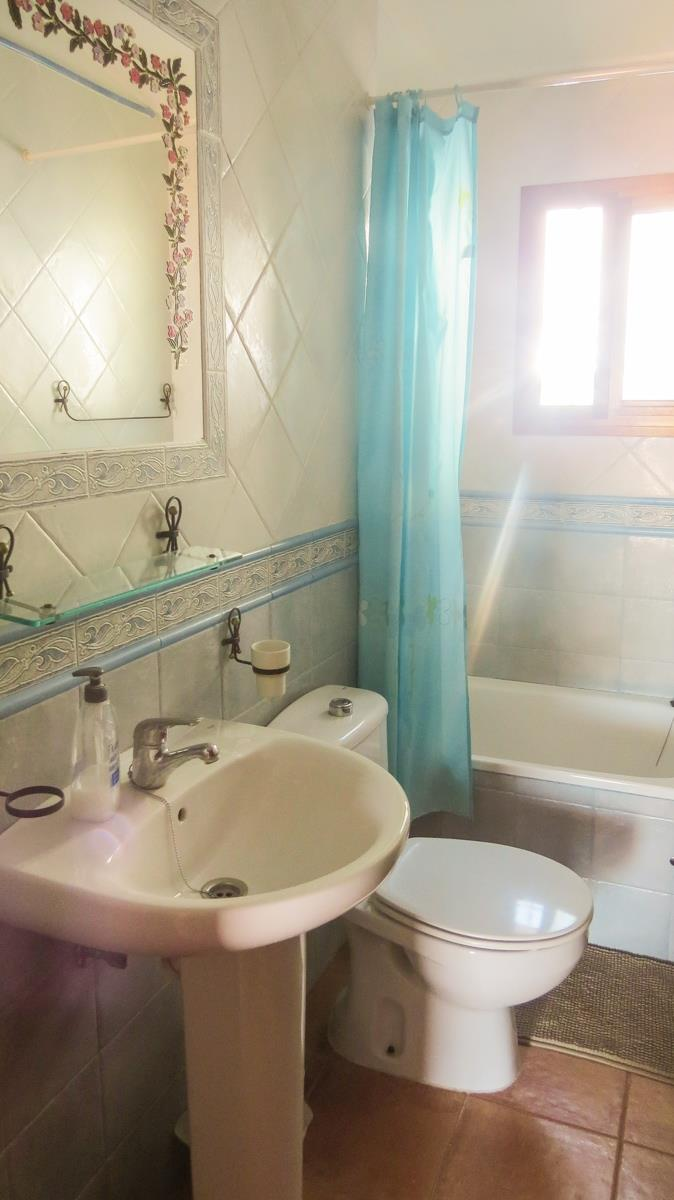 Bathroom with bathtub / shower, sink and toilet