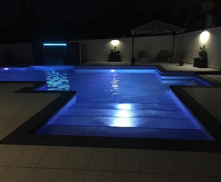 Pool steps at night, so inviting for that late night swim