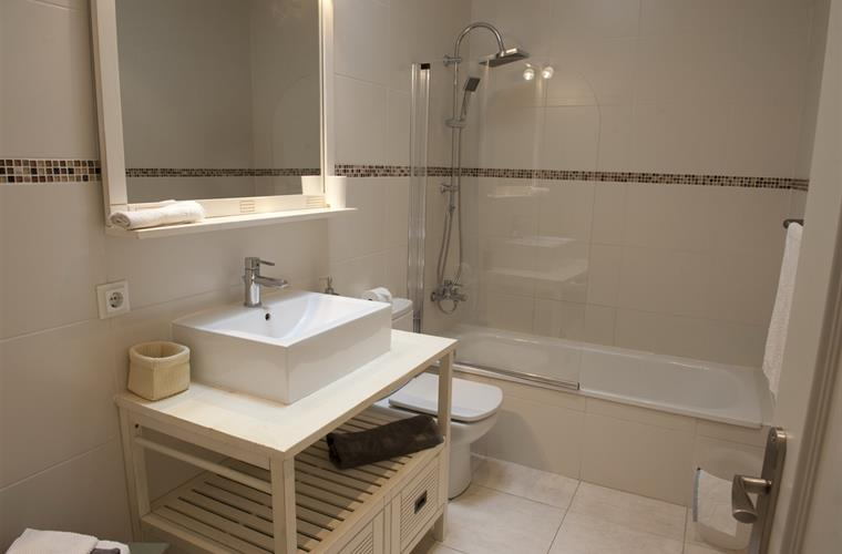 two bathrooms like this plus additional wc & separate shower unit
