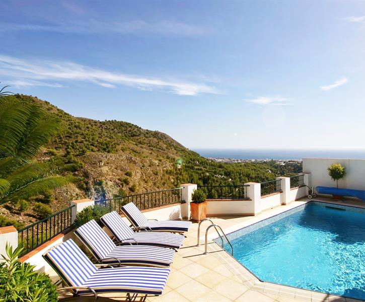 Terrace at swimming pool with mountain and sea view