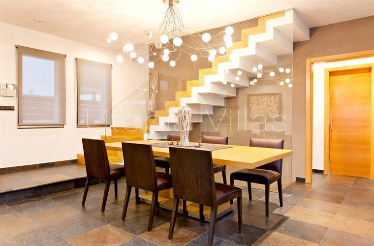 Dining room and stairs to the top floor