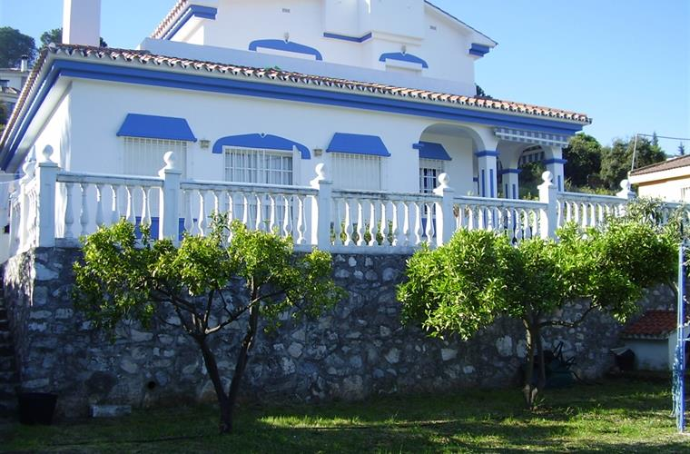 Front of the villa and fruit orchard