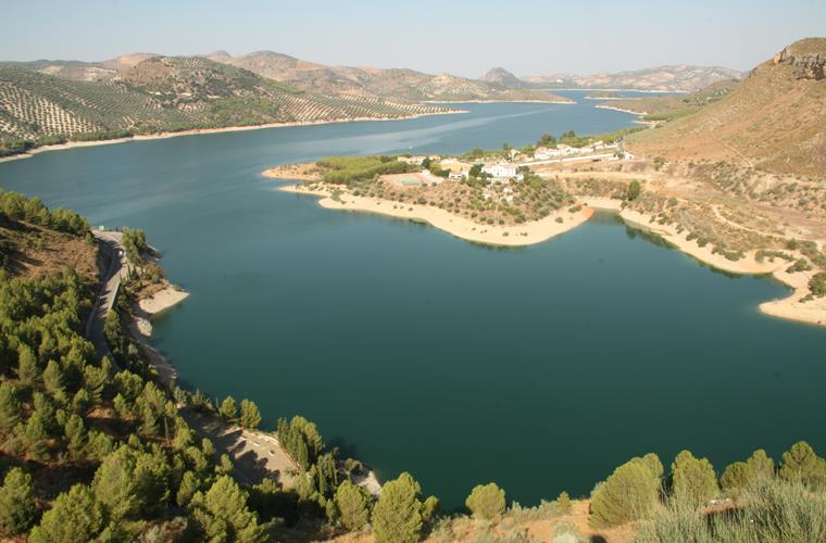 Iznajar lake with its beach, kayaks, pedalloes and beachbars